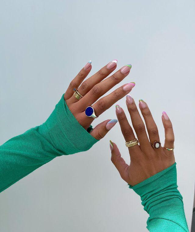 Summer nail designs: Amaka wearing pastel stripe French tips