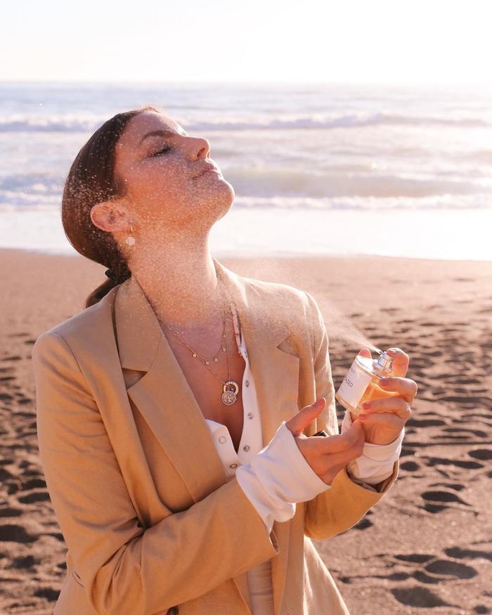 Best Affordable Fragrance: Emma Hoareau applying perfume