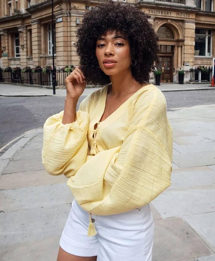 asos long crinkle sleeve top: asos lesley wearing the yellow version