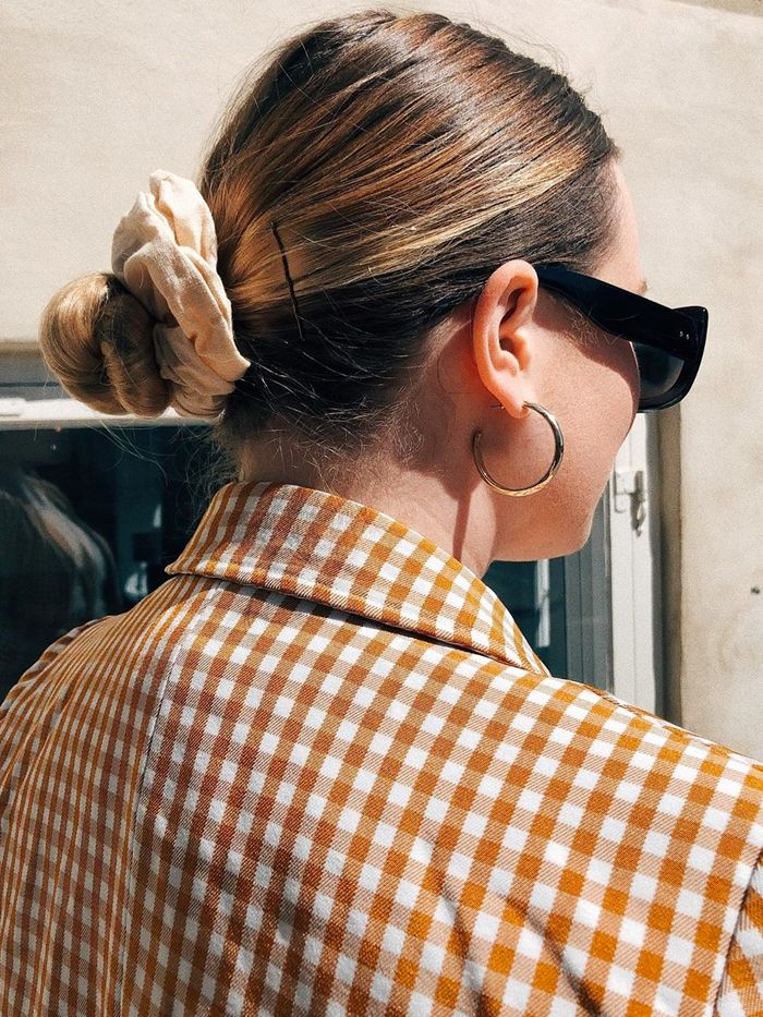 best hair scrunchies: asos lotte wearing one in a low bun