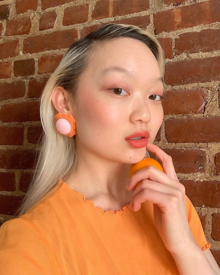 Long hairstyles for women: Jessica Wu with long hair and orange top