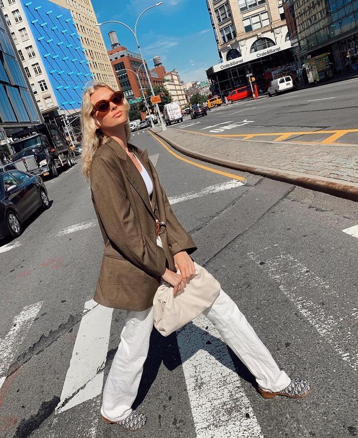 Elsa Hosk style: white jeans and blazer and Bottega Pouch bag