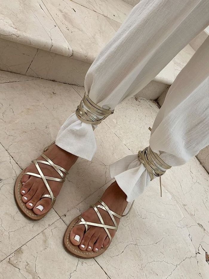 White Pedicure: Strappy gold sandals and white nails
