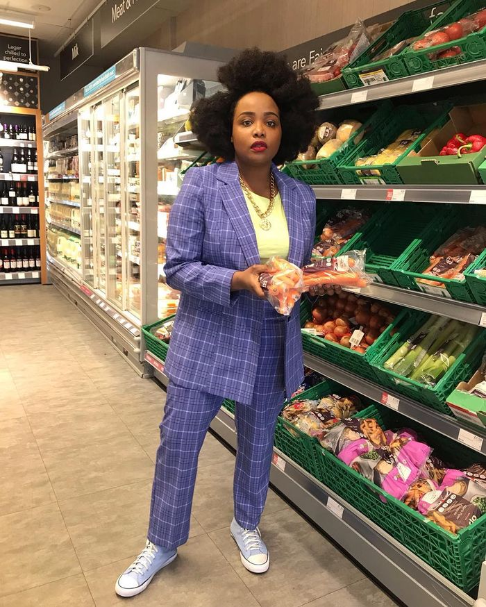 Supermarket beauty products: Ada Oguntodu wearing blue suit and converse