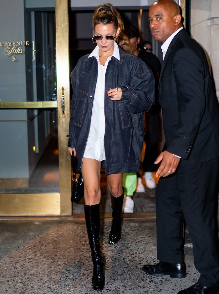 celebrity shoe trends 2019: Bella Hadid in black patent knee boots