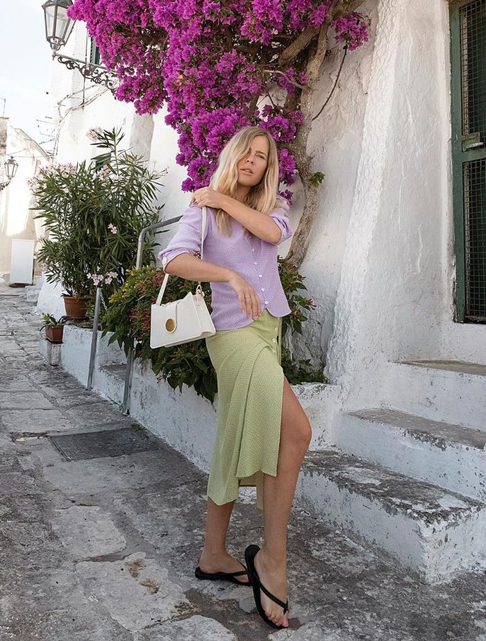 Green and Lilac Outfits: Jessie Bush wears a lilac top and green skirt