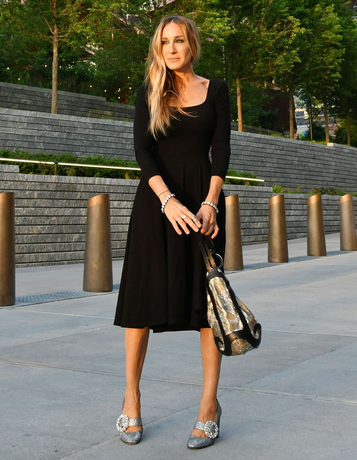 Sarah Jessica Parker in a black dress and glitter heels