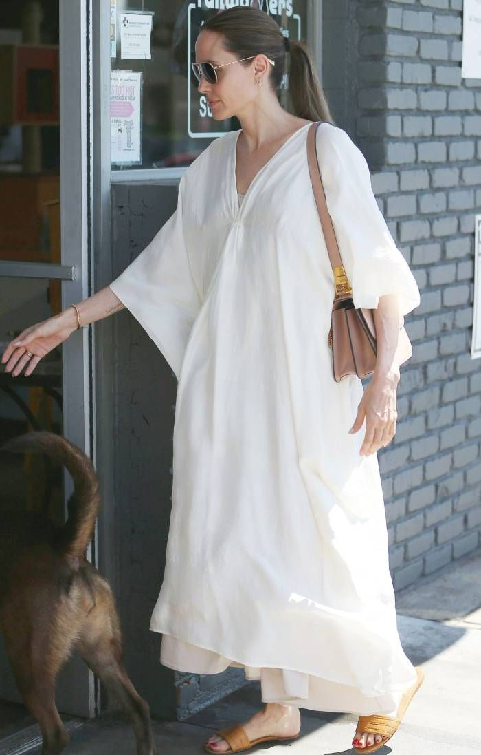 angelina jolie wearing a kaftan, sliders, bag and aviators