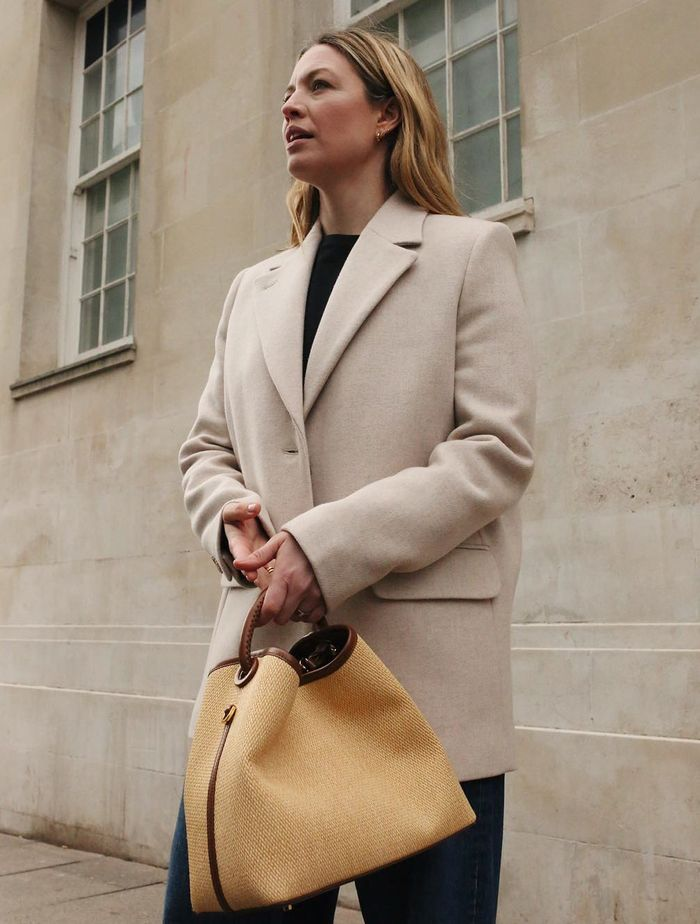 & Other Stories Wool Blazer: Alexis Foreman wears the blazer with a black tee, tailored trousers and a magnolia bag