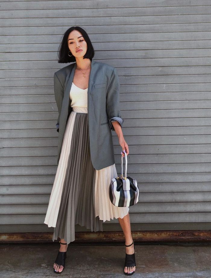 Blazer and Skirt Outfit Ideas: @handinfire wears a grey blazer and pleated skirt