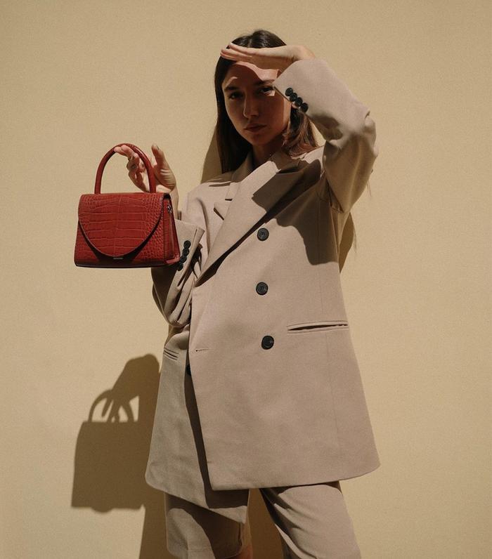 Autumn accessories: Beatrice Gutu wearing Charles & Keith bag