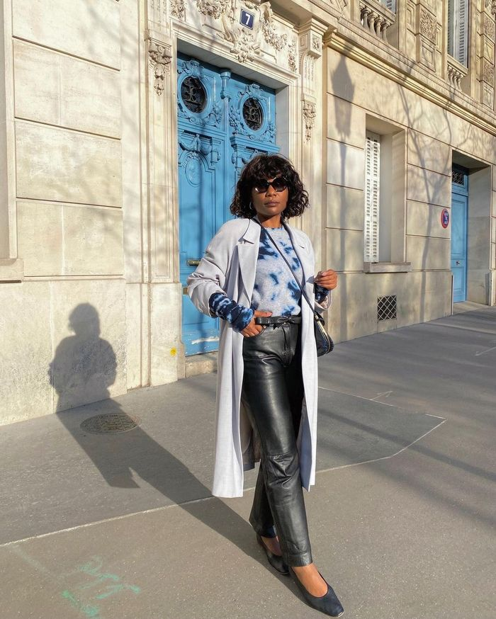 French girl hairstyles: Jeanne Damas wearing cropped cardigan and jeans