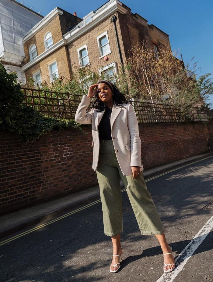 Best Beige Blazer: Karina Marriott wears her beige blazer with khaki cropped trousers, white sandals and a plain black t-shirt.