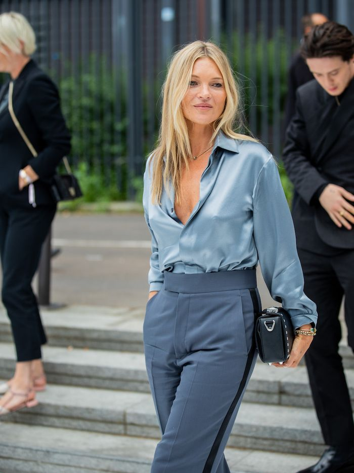 Best skincare routine for 40s: Kate Moss wearing blue silk shirt and trousers