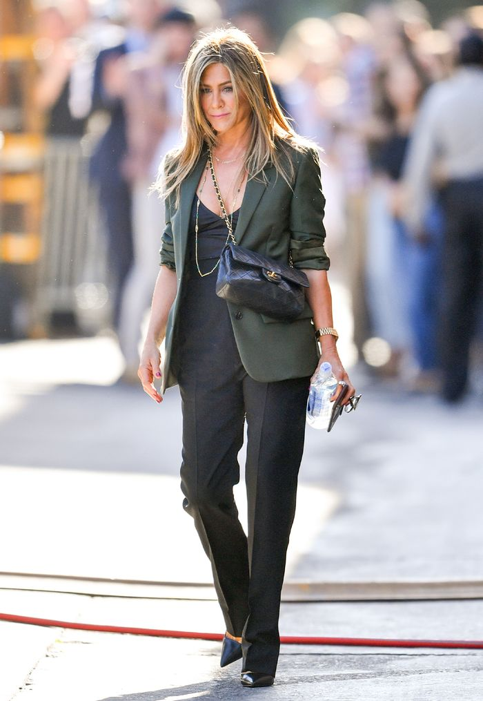 Jennifer Aniston outfit in a blazer and Chanel bag