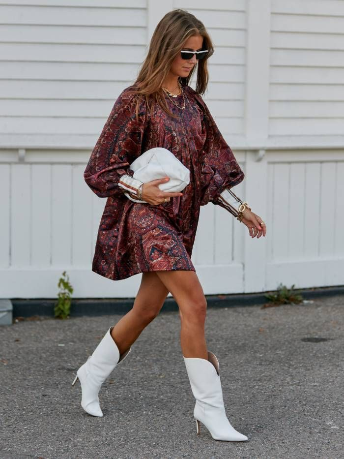best white ankle boots: street styler during copenhagen fashion week wearing white ankle boots