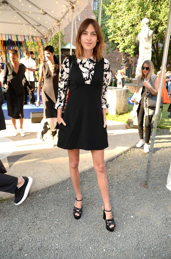 Platform Heel Trend: @alexachung wears a pair of black leather platform heels
