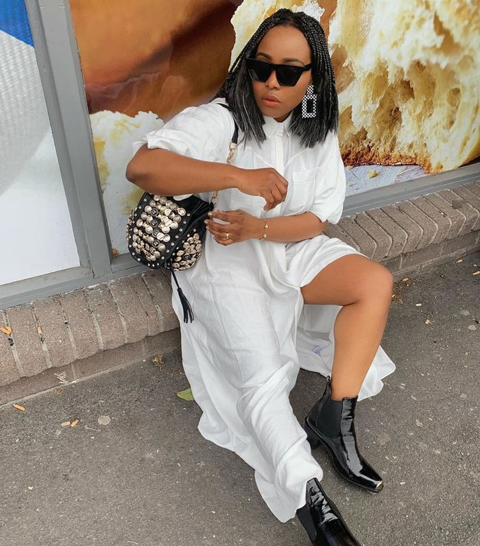 Boots and dresses: Ada wearing white dress and black Nasty Gal boots