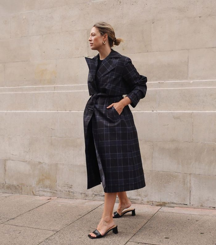 Transitional items:  Alex wearing navy checked trench