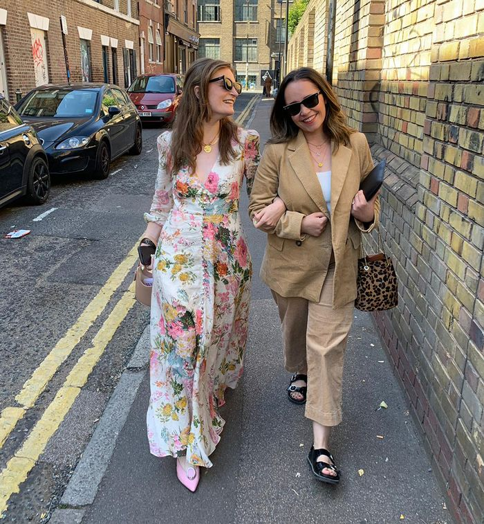 Emma Spedding and Elinor Block at LFW in a floral dress and corduory suit