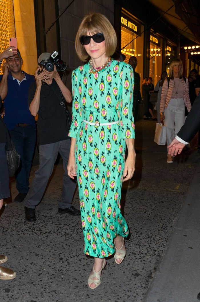 Anna Wintour Fashion Week Outfits: Anna Wintour in a printed dress and statement necklaces