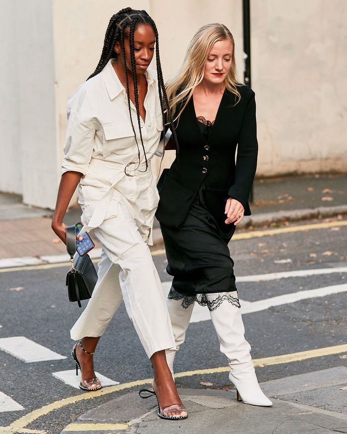 The Best London Fashion Week 2019 Street Style Trends: Chrissy Rutherford and Kate Foley in black and white aesthetic outfits