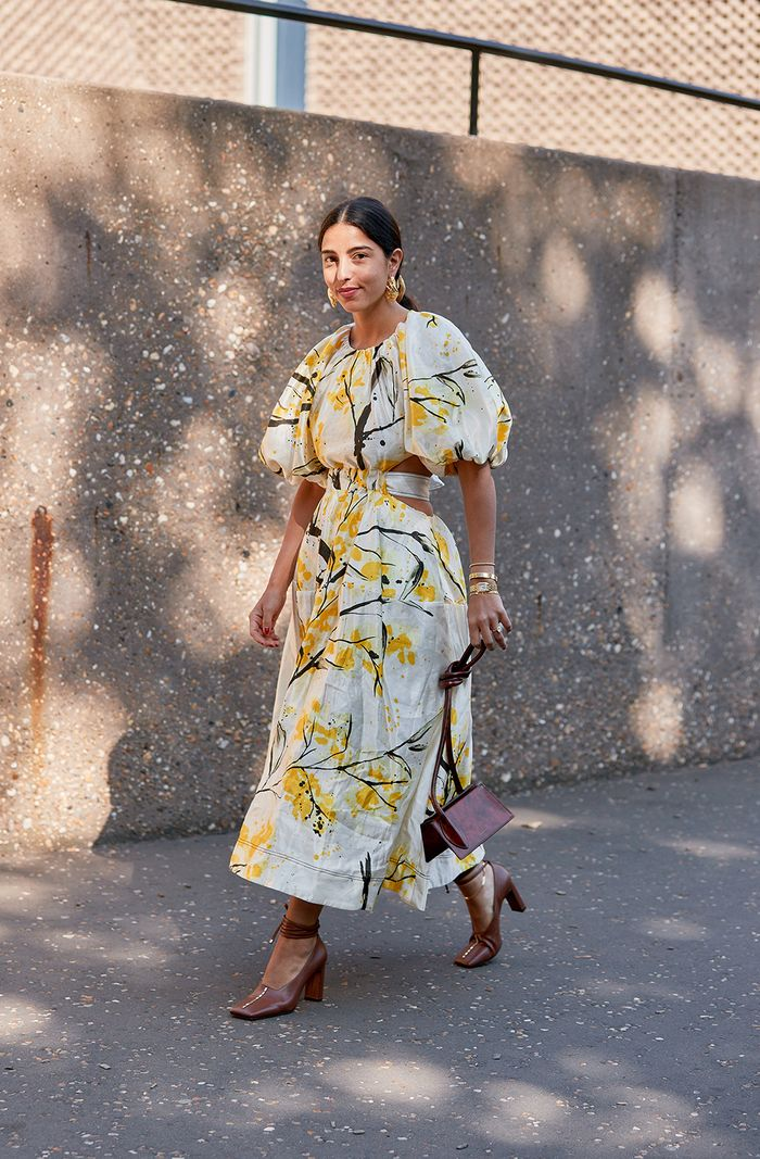 Puff sleeve dress trend 2019: Bettina Looney wearing a yellow and white midi