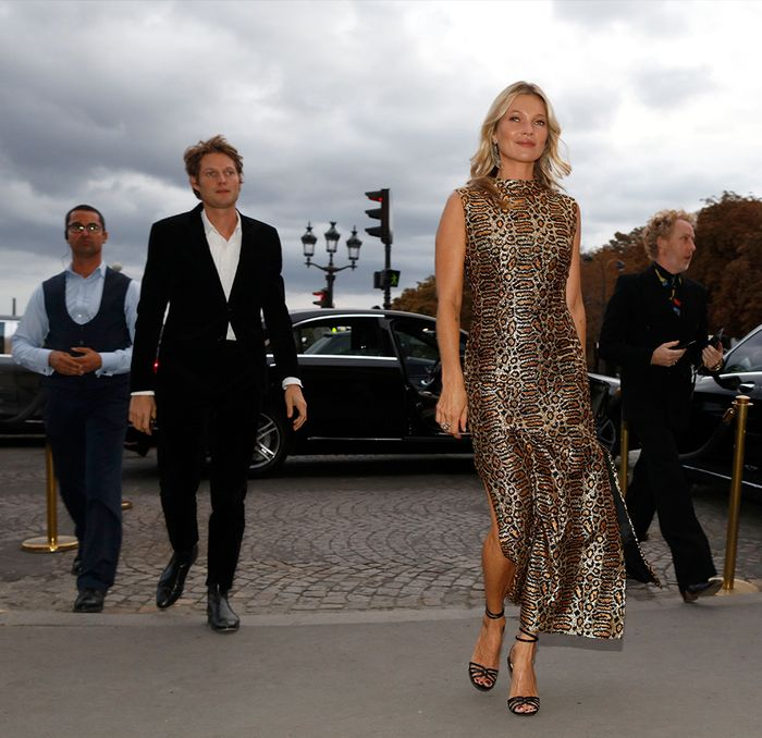Kate Moss wearing a leopard print dress in Paris
