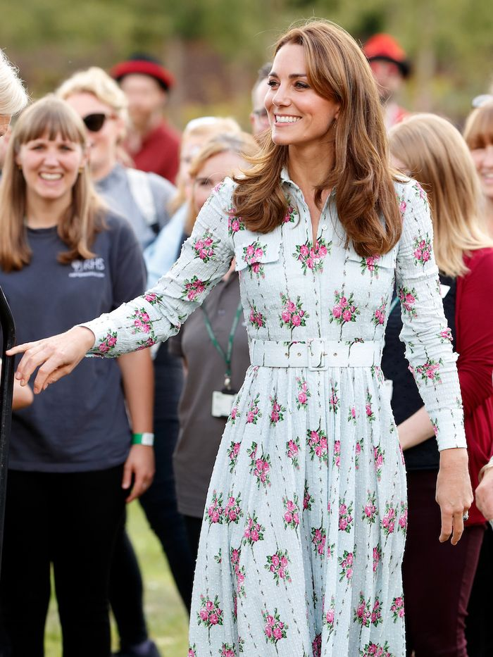 Kate Middleton Hairstyles: Kate wearing blue floral dress with bouncy blow-dry