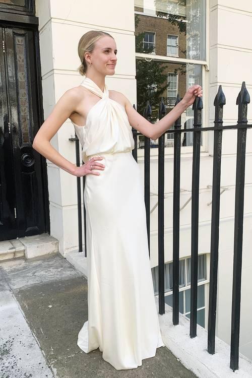 Best ASOS wedding dresses: Joy wearing white ASOS dress