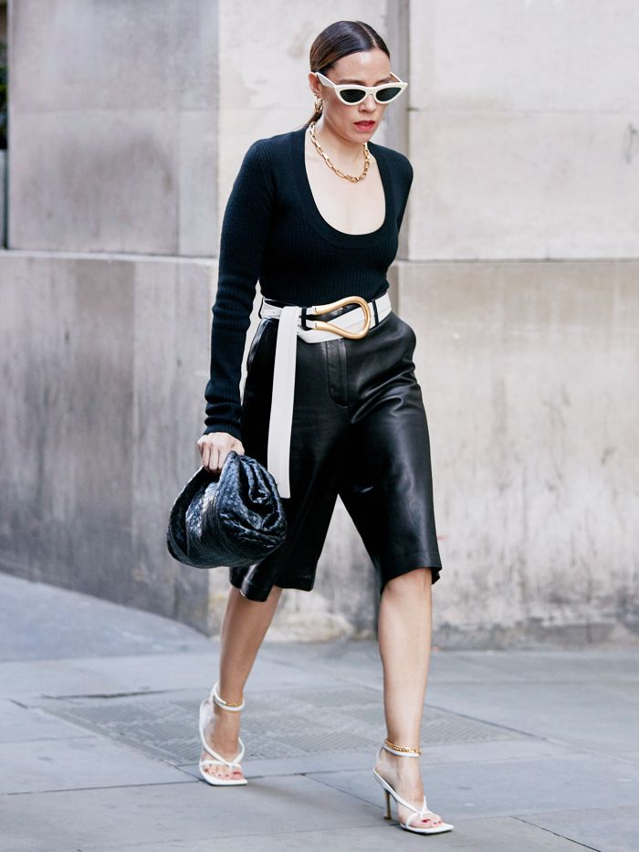 autumn accessory trends 2019: street style look including a gold chain, big belt, clutch bag and square-toe shoes