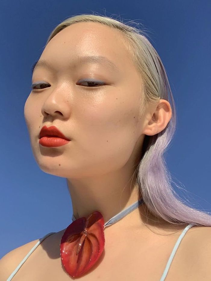 Best Cheap Concealers: Jessica Wu wearing red lipstick and blue eyeliner