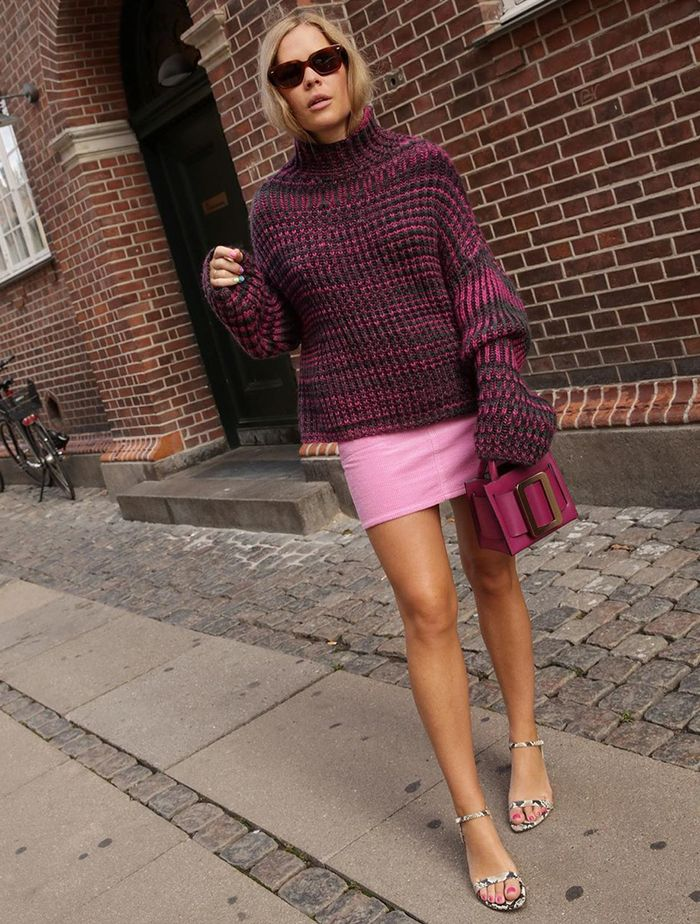 What to Wear in October: @wethepeoplestyle wears a chunky knit and mini skirt