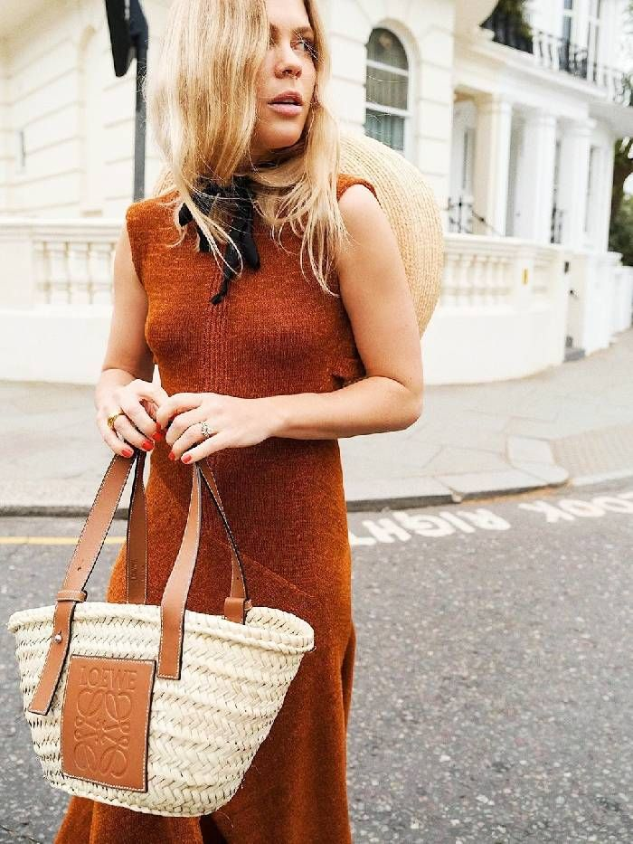 Jessie Bush styled her Loewe raffia basket tote with a knit dress and straw hat earlier this summer.