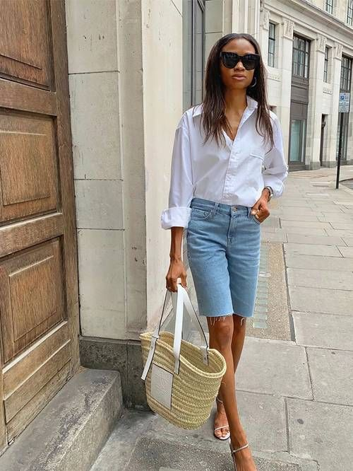 Lorna styled her Loewe raffia basket tote with a crisp white shirt, denim shorts, and strappy sandals