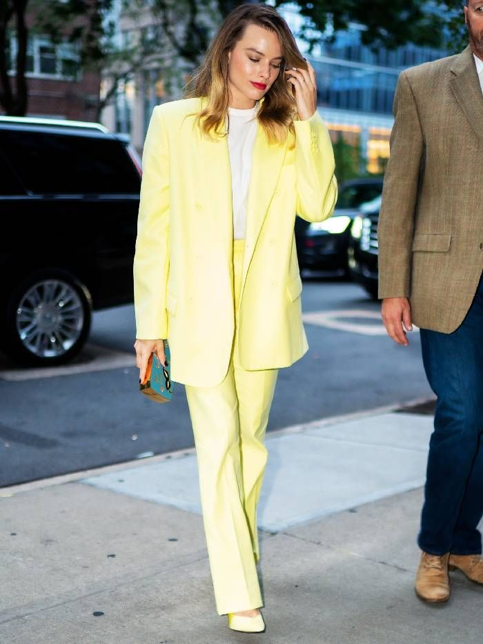 Margot Robbie wears yellow suit from The Attico with a white t-shirt  in New York.