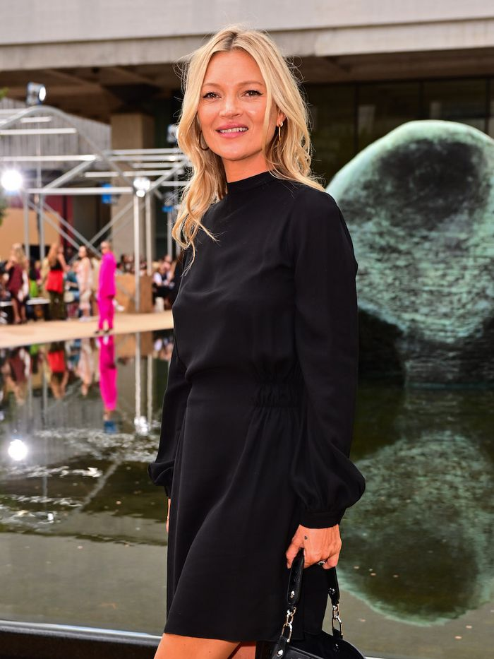 Kate Moss Skincare: Kate Moss wearing black mini dress