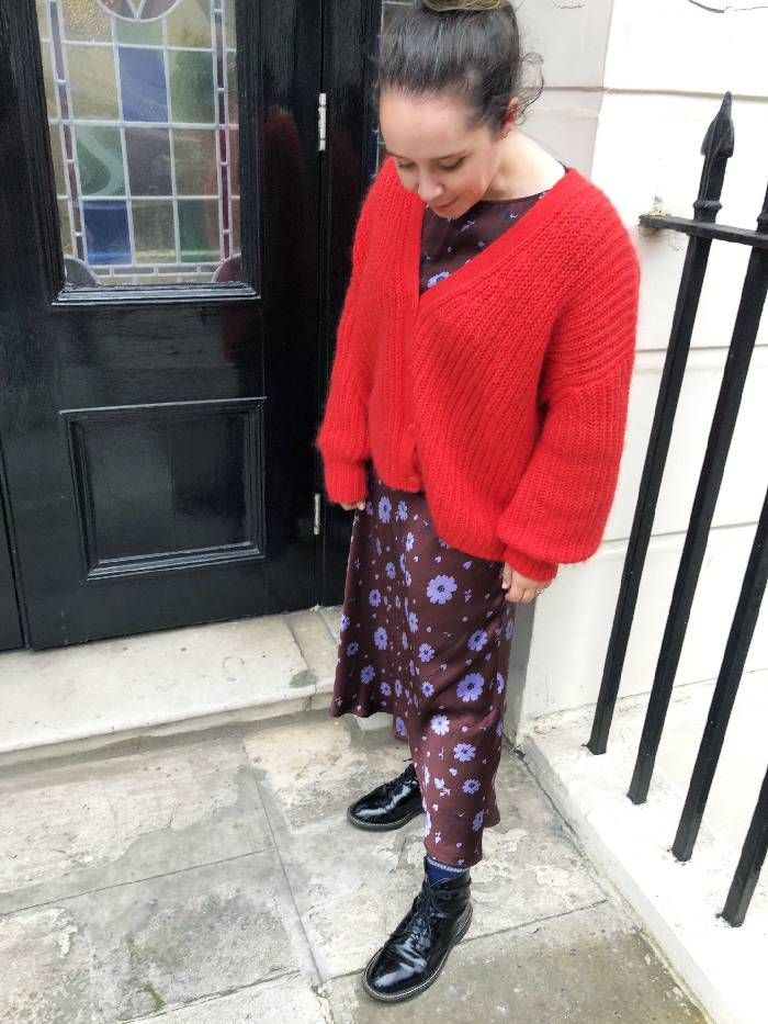 Nell Block wears her Asos patent black boots with a Ghost dress and red cardigan