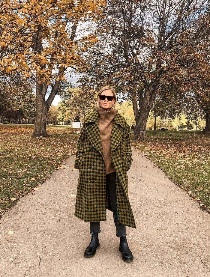 Countryside Outfit Ideas: @wethepeoplestyle wears a checked coat and cropped jeans
