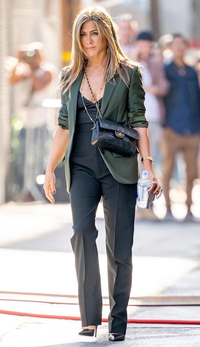 Jennifer Aniston fashion in a blazer and Chanel bag