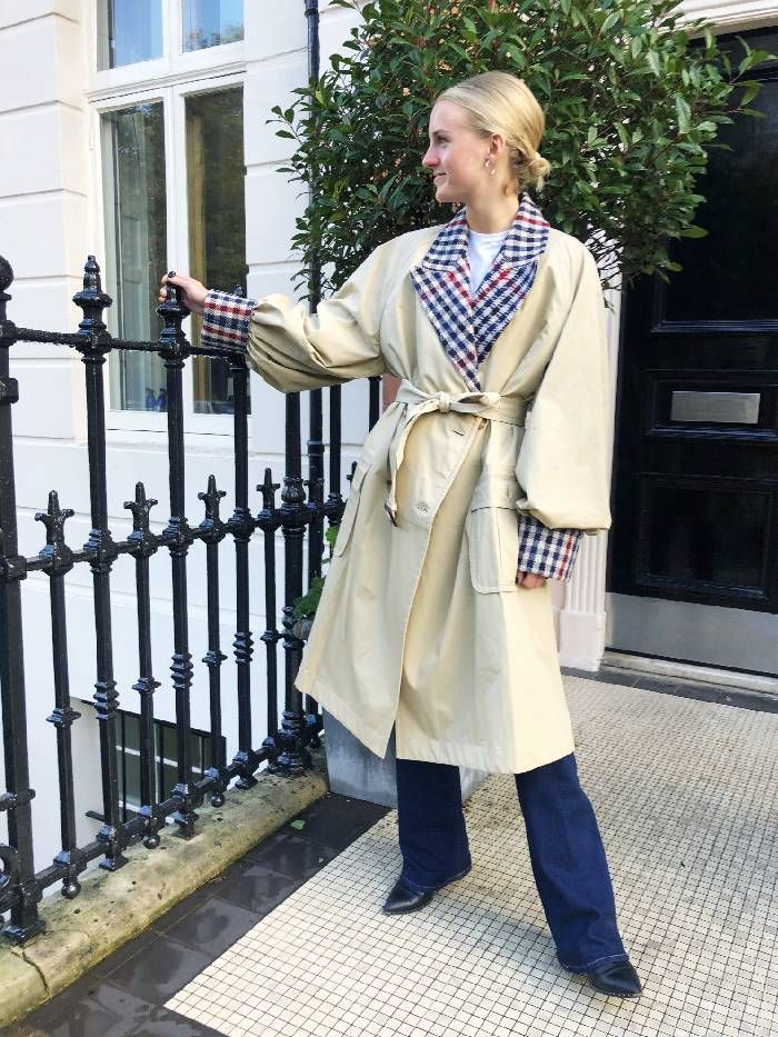 Joy Montgomery wears the J.W. Anderson trench coat with flared jeans.
