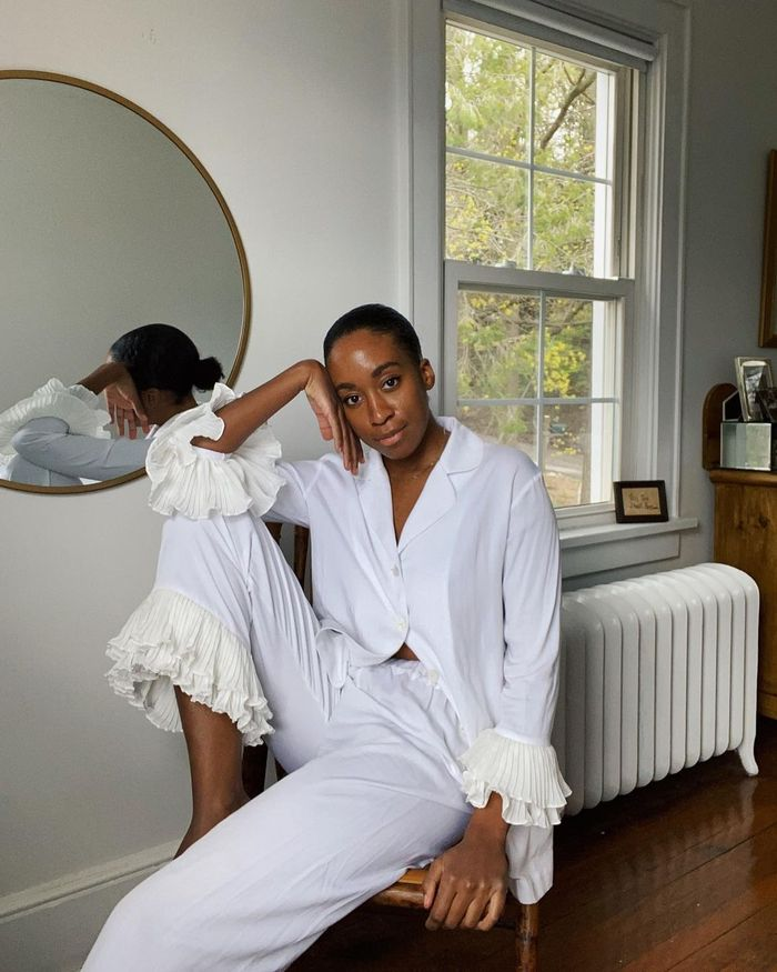 Face Halo: Chrissy Rutherford wears ruffled white pyjamas