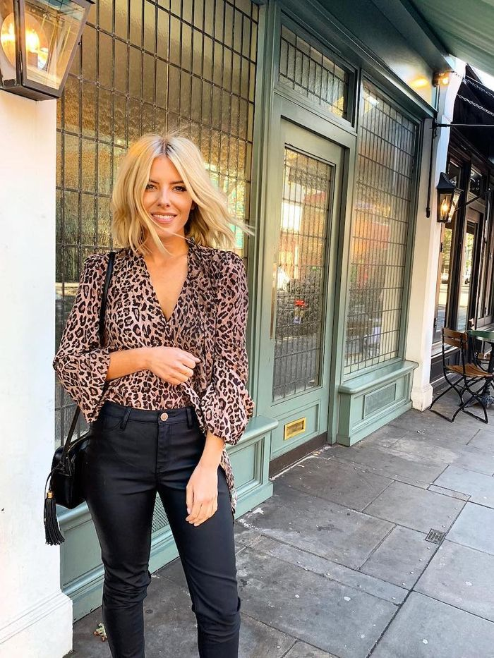 Mollie King Skincare: Mollie wearing leopard print blouse and black skinny jeans