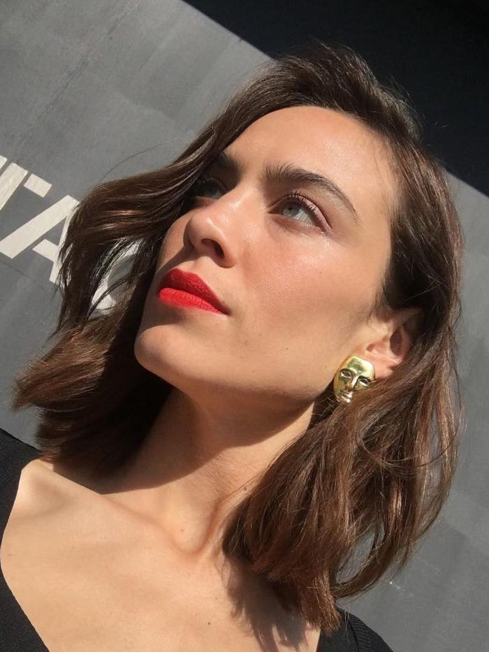 Alexa Chung Hair Products: Alexa with waves and red lipstick