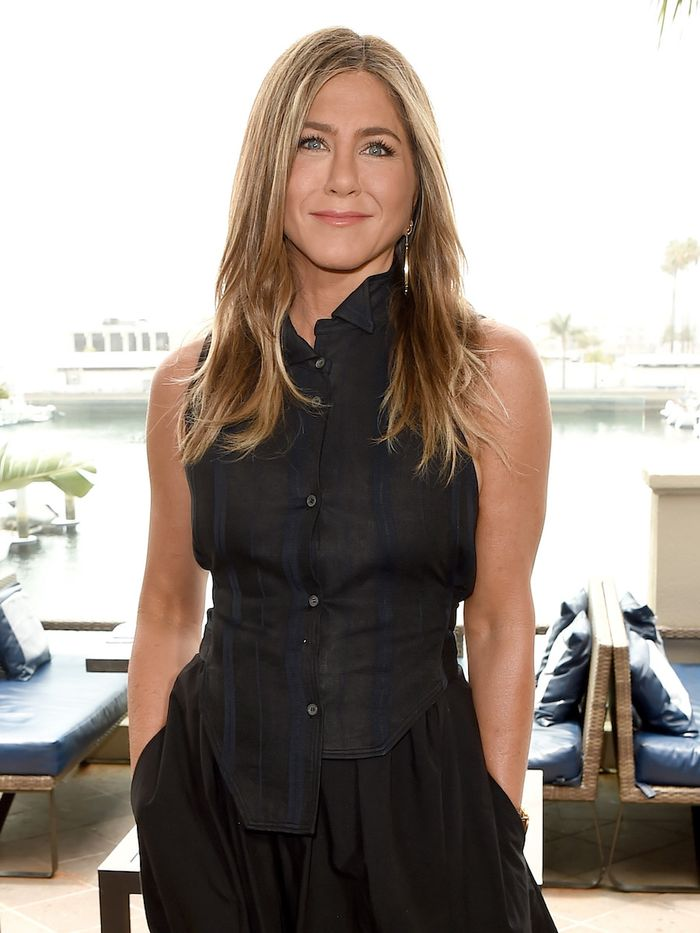 Jennifer Aniston Skincare: Jen wearing black outfit and layered hair