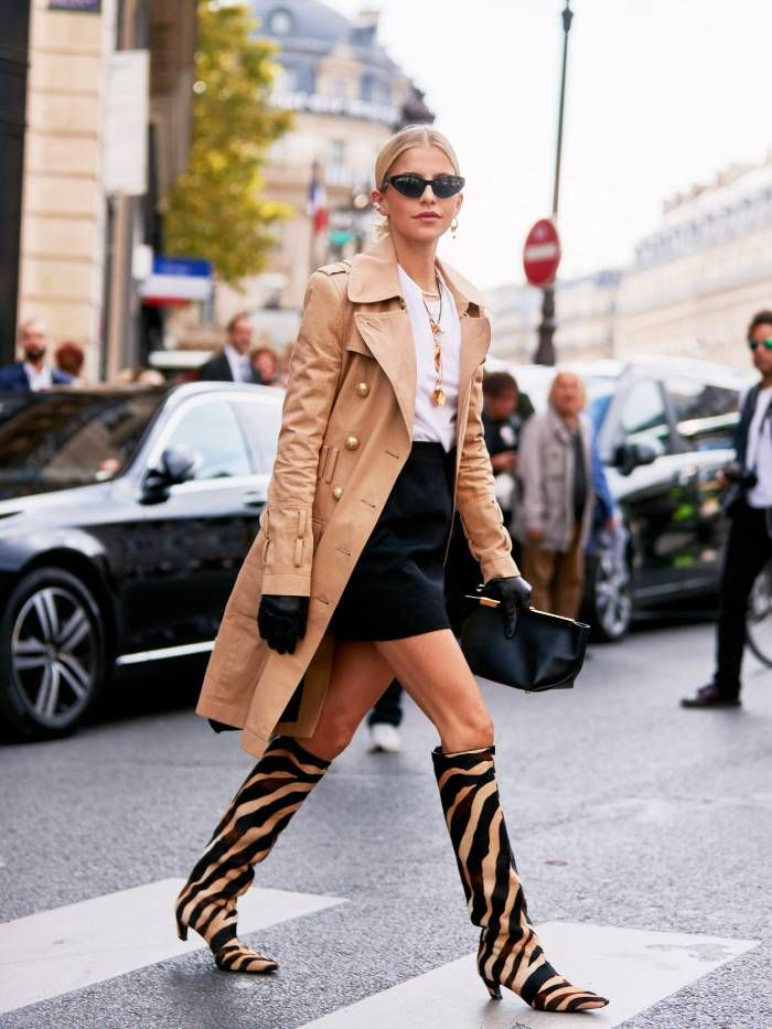 Cara Dour Wearing Khaite boots and bag at Fashion Week