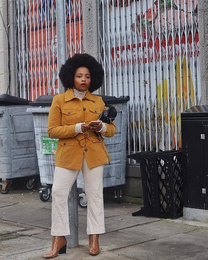 How to Wear Light Jeans In Winter: @ada_oguntodu in a pair of light jeans