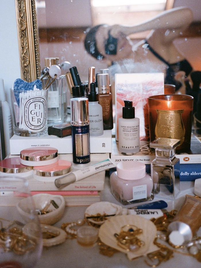 Classic Beauty Products: Gold jewellery and products on dressing table