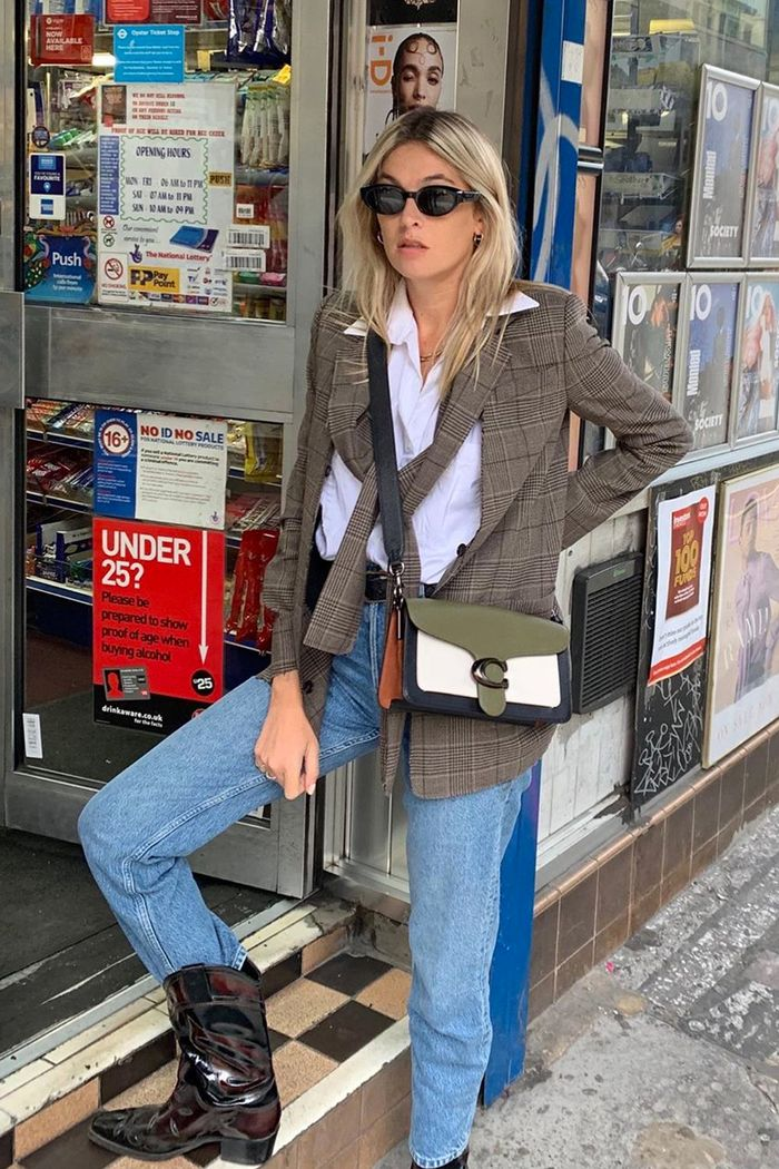 Boots over jeans outfits: Camille Charriere