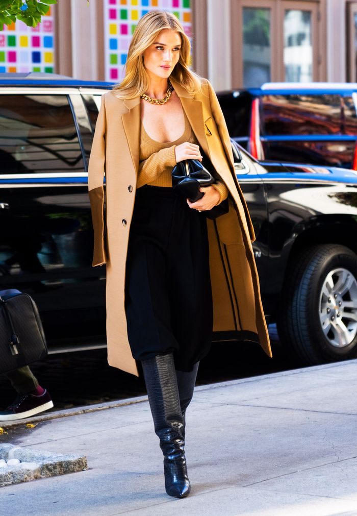 Rosie Huntington Whiteley autumn outfit: camel coat and knee high boots